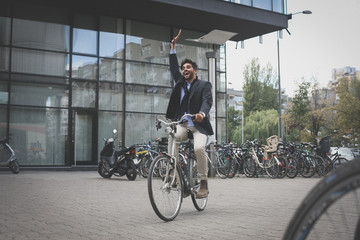 Young businessman on bike.