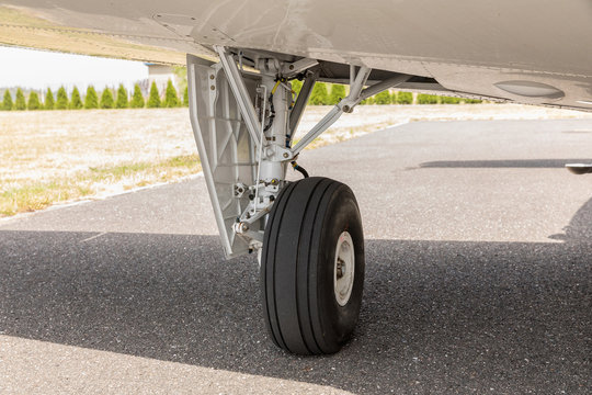 wheel of airplane, Close up of aircraft wheel on runway , Plane wheel, jet plane