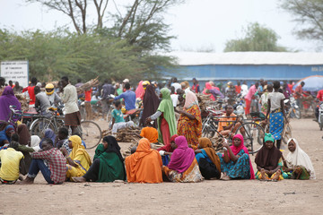 Women wait in line to receive aid at the Kakuma refugee camp in northern Kenya