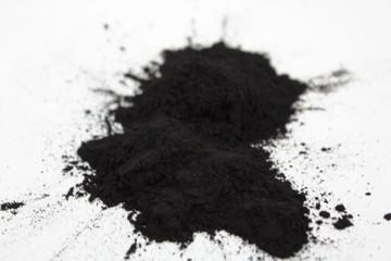 Splash charcoal black powder on white background