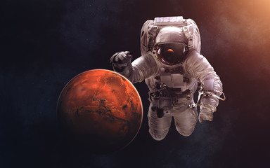 Mars and giant astronaut. Image in 5K resolution for desktop wallpaper. Elements of the image are furnished by NASA