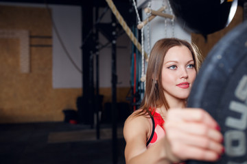 Photo of athlete woman with barbell