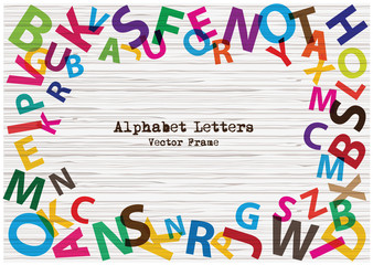 Set of bright rainbow alphabet letters on textured wooden background. Cartoon vector frame of colorful alphabet letters.