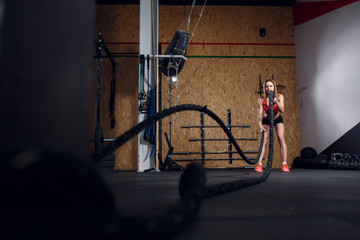 Picture of sports woman in training with two ropes