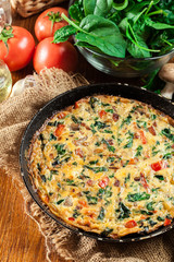 Frittata made of eggs, mushrooms and spinach