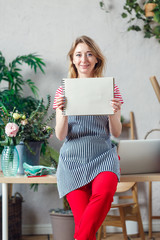 Image of florist woman with blank sheet of notebook