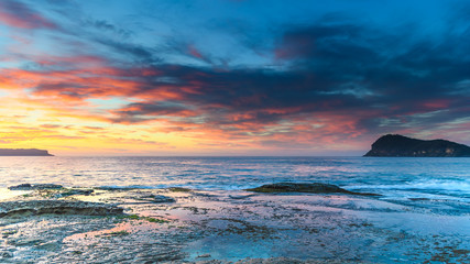 Vibrant Sunrise Seascape with Clouds and Island