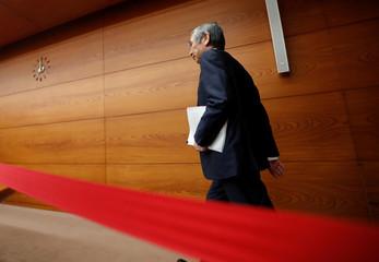 Bank of Japan Governor Haruhiko Kuroda enters a news conference room in Tokyo