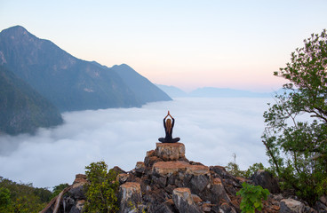 Serenity and yoga practicing,meditation at mountain range