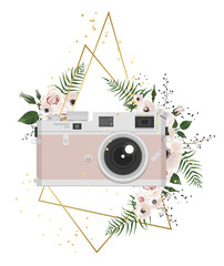 Vintage retro photo camera in flowers, leaves, branches on white background