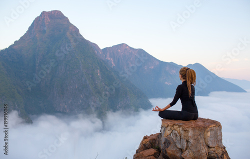 Fototapete Serenity and yoga practicing,meditation at mountain range