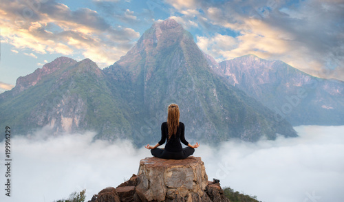 Wall mural Serenity and yoga practicing,meditation at mountain range