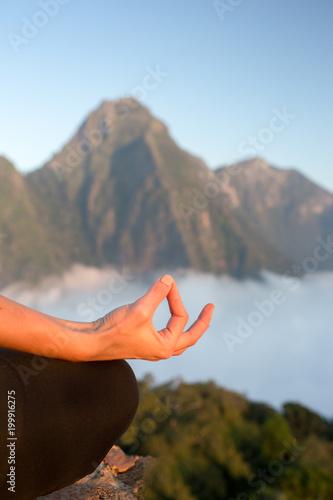 Wall mural Serenity and yoga practicing,meditation at mountain range