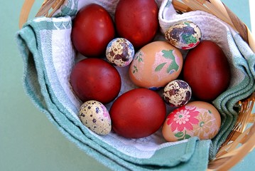 Decorated Easter eggs in a wicker basket