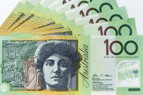 Currency banknotes spread across frame australian dollar
