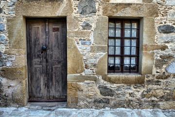 old wooden door and window on stone building