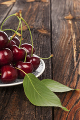 Fresh Ripe red cherries on wooden table