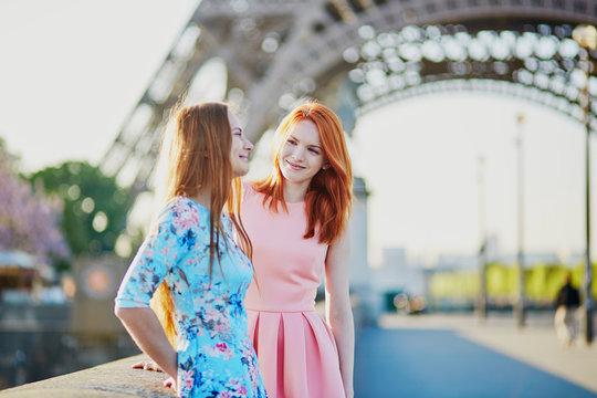 Two friends near the Eiffel tower in Paris, France
