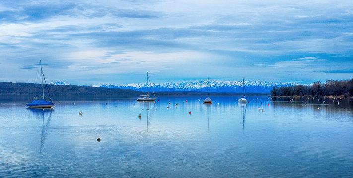 Ammersee lake Bavaria Germany with view to the snowy alp mountains