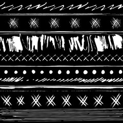 Vector hand-drawn striped seamless pattern made of ink strokes and smears in tribal style on a black background.