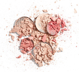 Broken face powder and blush isolated on white background
