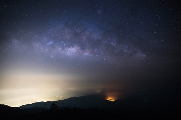 milky way on mountain with wildfire