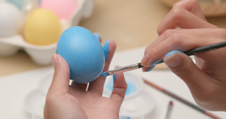 Easter holiday with painting chicken egg