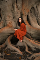Attractive woman in big roots
