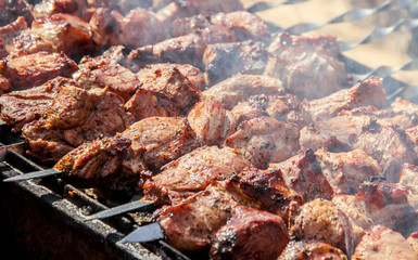 The meat is fried on the grill. Selective focus.