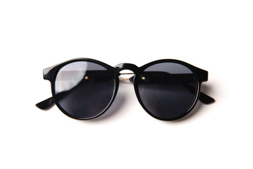 Stylish black sunglasses isolated on white background, top view Wall mural