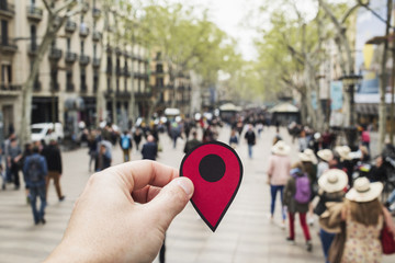 man with a red marker in Las Ramblas, Barcelona.