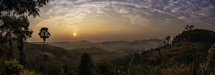 Landscape view of sunrise, mountains and foggy