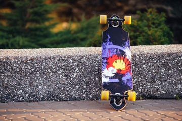 Colorful skateboard on a road in summertime