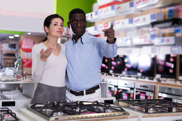 Couple  selecting hob  in  household store