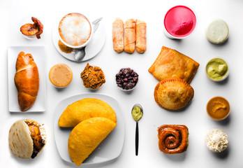 different types of Venezuelan meals, golfeados, tequeños, cachito, empanada, etc.