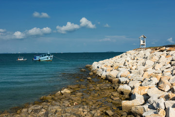 Seascape view of lighthouse and boat, Rayong