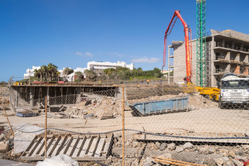 Concrete pump truck on the construction of a building of Los Abrigos in the south east of the island of Tenerife in Spain