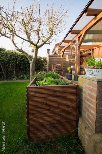 Hochbeet Im Garten An Der Terrasse Stock Photo And Royalty Free
