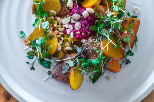 Vegetarian sweet potato salad with greens