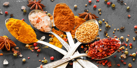 Spices and herbs. Variety of spices and herbs on a wooden surface
