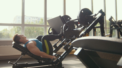 Strong man powerlifter on the strength training in a gym
