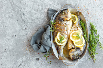 Poster Fish Baked fish dorado. Sea bream or dorada fish grilled