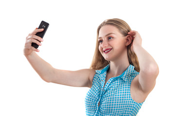 Young blonde girl taking selfie on a white background, keep smiling and feels happy