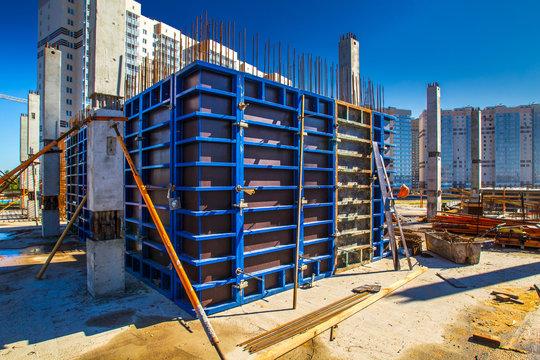 Home construction. Formwork for pouring concrete. Construction of a concrete house. Multi-storey construction.