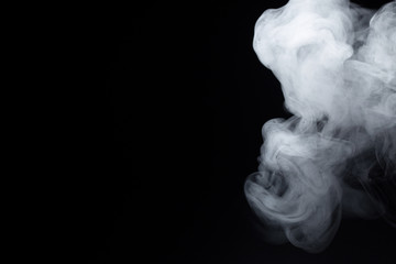cigarette white smoke on a black background on the right