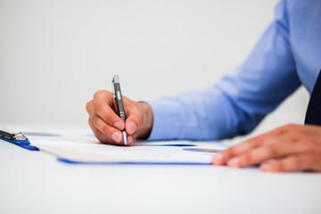 Closeup of a businessman writing documents