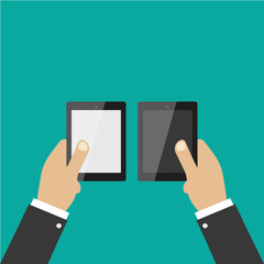 Hand holding pad, tablet on green background. Flat design