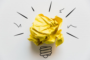 Creative idea. Concept of idea and innovation with yellow paper ball and light bulb