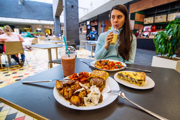 woman drink smoothies in mall cafe. lifestyle concept. lunchtime