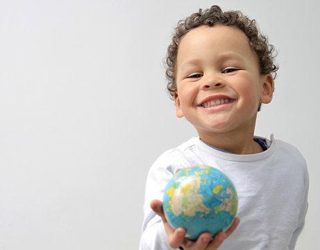 boy holding globe on earth day stock photo